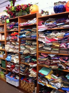 look at all this material at witch city consignment